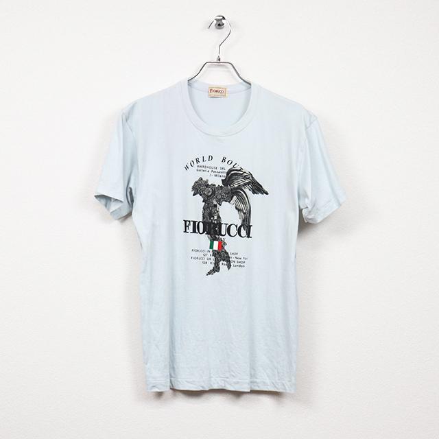 フィオルッチ(FIORUCCI)半袖プリントTシャツ Mサイズ コンディションB サックス 価格2,200円(税込)